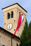 Bell Tower Hanged with Red and White Flag Royalty Free Stock Image