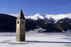 Bell tower ice. Alpine lake with a bell tower in the ice, Reschensee Stock Photography