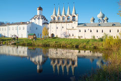 The bell tower and the Intercession church with the reflection in the monastery pond. Tikhvin assumption mo Stock Photo