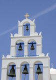 Bell Tower on Island Thira. White bell tower in the town of Oia on island Thira of Santorini archipelago of volcanic islands in Greece on blue sky background Royalty Free Stock Photography