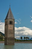 Bell tower in a lake on the Alps. Lake with an awash bell tower royalty free stock photo