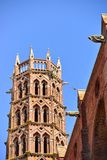 Bell tower of Les Jacobins church in Toulouse. France and gargoyles Stock Photo