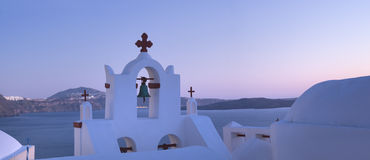 Bell tower of the local church in Oia village in the evening, pa Stock Photography
