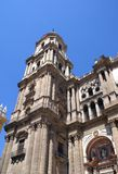 The bell tower of Malaga Cathedral in Malaga, Andalusia, Spain, Europe Royalty Free Stock Images
