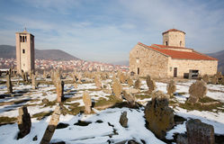 Bell tower and medieval tombs. NOVI PAZAR, SERBIA: Bell tower, medieval tombs and 9th century Orthodox Church of St. Peter. The Stari Ras complex was designated Stock Photos