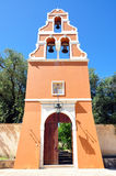Bell tower at the monastery, the island of Corfu, Greece. Bell tower and gate of the monastery, the island of Corfu, Greece Royalty Free Stock Images