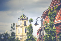Bell tower in the morning light in Vilnius on background blue sk Royalty Free Stock Images