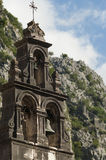 Bell tower in the mountains. Old town of Kotor, Montenegro Stock Photos
