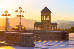 Bell tower near Holy Trinity church sunset panorama in Tbilisi, Georgia stock photo