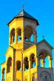 Bell tower near Holy Trinity church sunset view in Tbilisi, Georgia stock photo