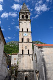 Bell tower next to church Royalty Free Stock Photos