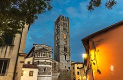 Free Bell Tower Of Chiesa Di San Frediano Catholic Church And Building With Street Lamp Light On Piazza Del Collegio Square In Historic Stock Photo - 139939150