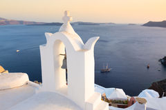 Bell tower in Oia, Santorini island, Greece. Stock Photos