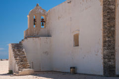 Bell tower of an old catholic church In Portugal. Chapel of Fortaleza de Sagres, Algarve, Portugal Stock Images