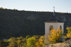 Bell tower in Old Orhei, Moldova landmark. Christian Orthodox rock monastery stock images