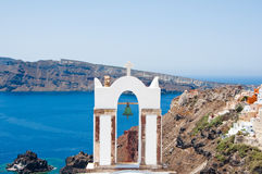 The bell tower of orthodox church in Oia on the Island Santorini, Greece. Royalty Free Stock Photography