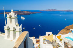 Bell tower of Orthodox church with view over volcanic caldera at Fira, Santorini Island, Greece Stock Image