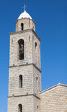 Bell tower of Propriano church, gray stone facade Stock Photography
