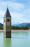 The bell tower in Reschensee (Italy). Royalty Free Stock Photo
