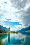 Bell tower of the Reschensee Royalty Free Stock Images