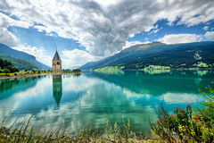 Bell tower of the Reschensee Stock Photo