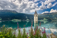 Bell tower of the Reschensee Royalty Free Stock Photo