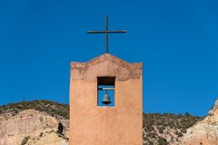 Bell tower and rustic wood cross at Monastery of Christ in the Desert in New Mexico royalty free stock photo