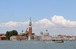 Bell tower of Saint George in the venetian lagoon and the boat Royalty Free Stock Images