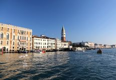 Bell tower of saint mark and houses view from grand canal Stock Images