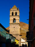 Bell tower of San Francisco Convent in Potosi. Cerro Rico on background. Potosi, Bolivia Royalty Free Stock Photography