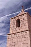 Bell Tower in San Pedro de Atacama, Chile. It is taken in Atacama desert, Chile. The photo shows a bell tower next to a small church in Atacama desert Stock Photography