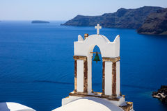 Bell tower in Santorini, Greece. Santorini, Greece - Bell tower and caldera view Stock Photography