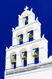 Bell tower with seven bells of Panagia Platsani in Oia, Santorini, Greece royalty free stock image