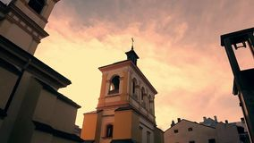 Bell tower on sky background. Old church on evening sky background. Moving clouds stock video footage