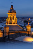 A bell tower in the sky of Seville Royalty Free Stock Photos