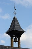 Bell tower. A small bell tower with blue sky in background Stock Photo