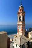 Bell tower in Sori, italy. Bell tower and village of Sori, small town in Liguria, Italy Stock Photo