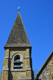 Bell tower and spire on a English church Stock Images