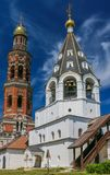 Bell tower of St. John the Theologian monastery in the background of clear sky.  Stock Photo