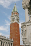 Bell Tower of St Mark and a statue of the palazzo ducale Royalty Free Stock Photography
