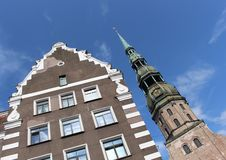 The bell tower of St. Peter`s Church. Gothic Lutheran Church in Riga, Latvia stock image