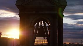 Bell Tower of St. Petersburg Cathedral during amazing sunset on cloudy sky with lense flare effect Royalty Free Stock Photo