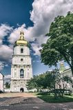 The bell tower of St. Sophia Cathedral in Kiev, Ukraine. View from the courtyard. The bell tower of St. Sophia Cathedral in Kiev, Ukraine. Summer View from the stock image