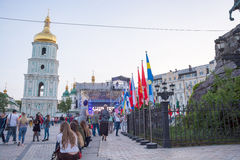 Bell tower of St. Sophia Cathedral, stage and flags of countries. Which Eurovision participants on the Sophia Square in the Kyiv, in Ukraine. 07.05.2017 Royalty Free Stock Photos