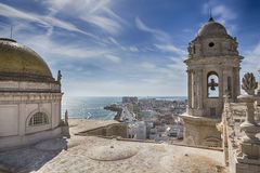 This bell tower and statues in the roof of the Cathedral of Cadiz, completed in the nineteenth century is located very close to t royalty free stock images
