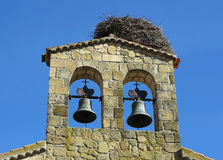 Bell tower and stork nests Royalty Free Stock Photos