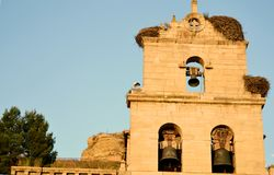 Bell tower with storks royalty free stock image