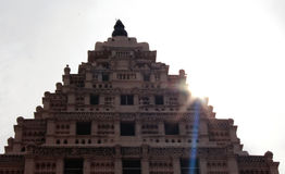 Bell tower with sun rays at thanjavur maratha palace. The Thanjavur Maratha Palace Complex, known locally as Aranmanai, is the official residence of the royalty free stock photo