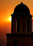 Bell Tower at Sunset. Seaside belltower of old mission building with ocean in background Royalty Free Stock Photography