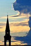 Bell tower at sunset on a cloudy sky Stock Photos